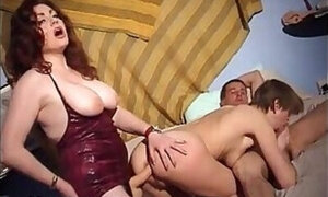 Impressive threesome with lots of strap-on action