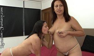 A lesbian drinks a straight woman's milk. xVideos