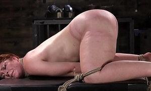 Spreadeagled bondage sub tied up and whipped