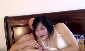 Penny Petals and her bald bf play with each other's dicks