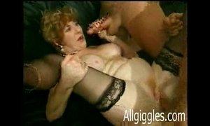 Mature blond Diane Richards takes four cocks