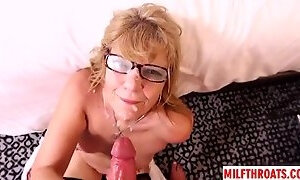 Granny in stockings gets glasses covered with sperm